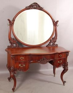 With shell carved crest on oval mirror with carved supports, Bombay sides with a curved serpentine front on cabriole legs. 70 t x 22 d x 52 w. Attributed to Horner Brothers, New York City. Funky Furniture, Unique Furniture, Furniture Design, Dressing Table Vanity, Dressing Tables, Vanity Table Vintage, Bedroom Comforter Sets, Tuscan Bathroom, Furniture Showroom