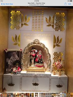 CREATIVE MANDIR'S FOR HINDU RELIGION IN CORIAN STONE ALONG WITH GOLD LEAF WORK DONE IN IT.