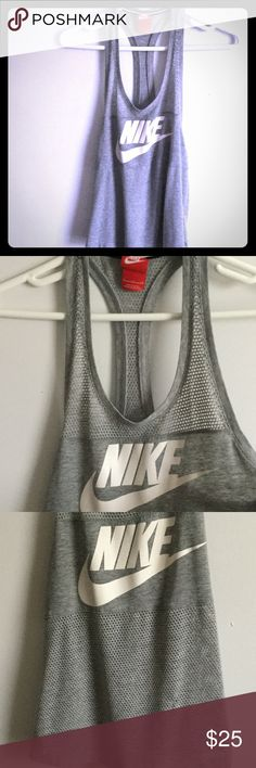 Gray Nike perforated racer back tank top Gray Nike perforated racer back tank top. White Nike symbol. Perforated in the back and top and bottom half of the front. In excellent condition. Nike Tops Tank Tops
