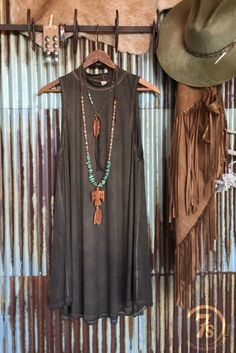 - Rustic looking leather swing dress/tunic - Tobacco acid wash fabric - Soft, lightweight and just the right amount of swing - Mock neck - Sleeveless - U-hem - Fitted thru chest, flowy below but lays
