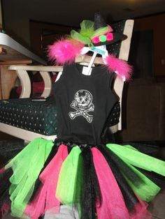 Halloween Costume Rockstar witch for my little girl! Made Tutu with ribbon around, used iron on skull for shirt, bought the little hat at Hobby Lobby. Super easy and cute!