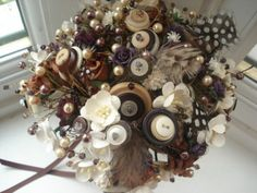 "A unique button bouquet - this website has a great step by step that I've been using to construct button ""flowers"" for my broach bouquet.  The buttons are another nod to my great aunt, Elayne. #DBBridalStyle"