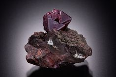 Cuprite  Copper Queen Mine  Bisbee, Warren District, Cochise County, Arizona  USA  Thumbnail: 1.8 x 2.3 x 2 cm