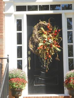 It is fall and people get inspired to decorate.  My client asked for a fall wreath. I wanted it to be a car stopper!