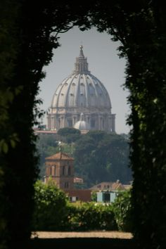 The Dome of St Peter's Basilica seen through the famous Maltese keyhole at Piazza Cavalieri di Malta, Rome, Italy