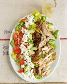 Crumbled bacon, feta cheese, sliced tomato, and avocado make this chicken cobb salad hearty and satisfying. Use leftover grilled chicken for this salad, or pick up a rotisserie chicken on your way home for a quick dinner.