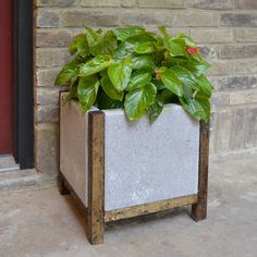 Easy DIY Wood and Concrete Planter - made with wood frame around concrete pavers and glued together