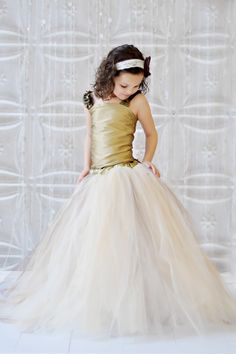 "For ""big girl"" flower girls...  Tutu Dress, Vintage Collection of Champagne, Ivory, Gold and Brown Long Tulle Skirt with a Gorgeous Gold Top Wedding This one would look good on Lauren I think."