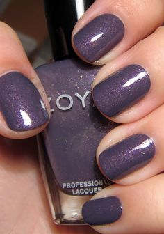 Zoya's Neeka, from their Fall 2011 Mirrors collection, is a spectacular polish. A dusty royal purple packed with flecks of larger gold shimmer. Still sophisticated, but with a lot of visual interes...