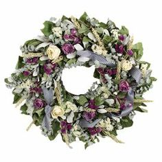 """Preserved wreath with eucalyptus and lavender roses.   Product: Preserved  wreathConstruction Material: Silicone and natural twigsColor: Multi Features: Includes preserved eucalyptus and rosesDimensions: 22"""" Diameter x 6.5"""" D Cleaning and Care: Wipe gently with a dry cloth"""