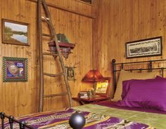 Knotty-pine beadboard was used on the walls and a ladder made of branches gathered from the surrounding woods leads to an additional loft area in this mountain home.