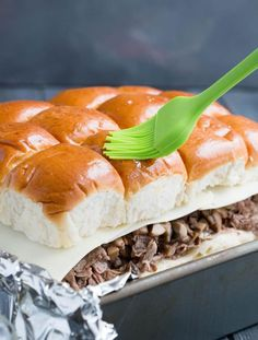 Tender shaved steak, fried onions and mushrooms, melty cheese and a buttery toasted bun make these sliders a delicious choice for game day. Free printable pennants make them fun! Philly Cheese Steak Sliders, Cheeseburger Sliders, Steak And Mushrooms, Stuffed Mushrooms, Slider Rolls, Hawaiian Rolls, Slider Recipes, Easy Bread, Fried Onions