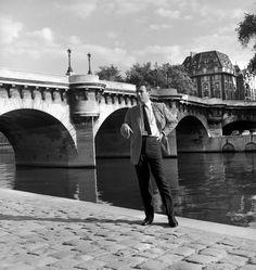 Yves Montand by the River Seine - Paris - France. Vintage Paris, City Lights, Brooklyn Bridge, Rue, Paris France, Louvre, Writers, Musicians, Travel