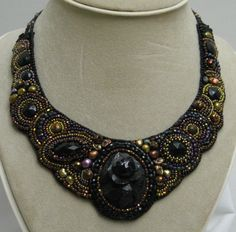 Bead Embroidered Necklace & Earrings by Fleurdelis with an antique black rose as its focal point. $250.00, via Etsy.