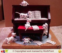 101 Dalmatians music box, top opens and another puppy is inside plays Cruella di Ville  sooooo cute