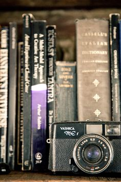 ... old books, old camera ....      I grieve a little bit for both...     Didn't know i felt this way ...        Extinction is hard on the eyes. h.berg