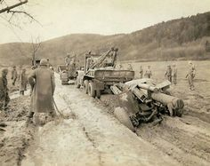 When this wrecker towing a 155mm Howitzer became stuck in the mud in a road, nothing less than a Bulldozer could budge it