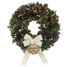 This Vintage Christmas 22'' Wreath is designed with preserved silver dollar eucalyptus, preserved cedar, icy cream berries, natural pine cones and their cream burlap bow with their vintage reindeer ornament.