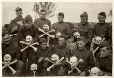 [Snapshot of group of 11 WWI soldiers, some holding human skulls and cross bones]  Vernon C. Perkins, American, 1894 - 1975 Thomas Jay Perkins, American, b. 1847  ca. 1918 gelatin silver print  Gift of Carol A. Perkins