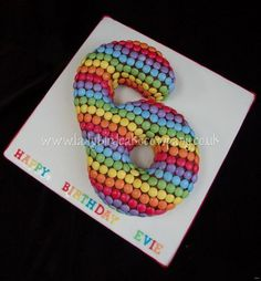 Colourful rainbow number 6 cake