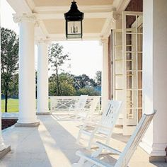 Classic front porch - columns, lantern, French doors . Lovely Everything !