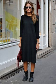 Black long sleeve midi dress and ankle boots.