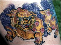 gold colored foo dog tattoo | Posted by somasekhar at 13:20