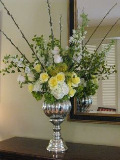 Mercury glass with yellow, green and white  by Fleur de Vie makes for a cool and elegant summer wedding or engagement party.