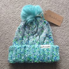 Confetti fleck pom pom beanie Brand new from Three Bird Nest. Adorable cable knit beanie with grey, white, blues, and greens knit in. Turquoise pom Pom on top. Three Bird Nest Accessories Hats