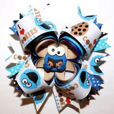 "4"" Cookie Monster Inspired Blue Stacked Hair Bow and Headband.    10% off by liking Lebelle Boutique on Facebook."