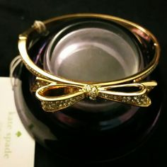 kate spade pave rhinestone love notes bracelet Authentic kate spade pave rhinestone bow bangle Hinged bangle in 12KT gold plated yellow gold Brand new, unused, no signs of wear or damage Includes kate spade dust bag kate spade Jewelry Bracelets