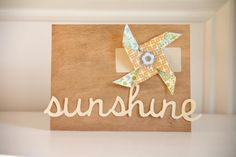 Need a card idea to send in August? This darling pinwheel sunshine card is just the ticket. The warmth of the various wood tones adds to the sunshine message. Happy Summer. Supplies Used: Cherry Wood Paper, Birch Wood Paper, Birch Wood Address Labels, pattern paper, button, sunshine word cut file, e-cutter and adhesive.
