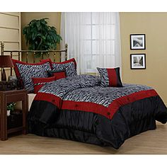 @Overstock.com - Sahara Zebra Print 7-piece Comforter Set - Amp up the decor in your bedroom with this amazing zebra-print comforter set. This luxurious set includes a comforter, a bedskirt, two shams, and three decorative pillows. Each item features faux fur with red trim, which fits nicely in a modern room.  http://www.overstock.com/Bedding-Bath/Sahara-Zebra-Print-7-piece-Comforter-Set/6341298/product.html?CID=214117 $76.99