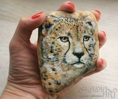 Natural stone ornamented with a hand-painted miniature of cheetah. Painted via photograph for Sylvia.