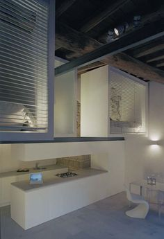 Mini Loft by Fabrizio Miccò Recovery of an ancient barn in the...