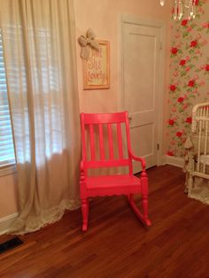 Hot pink rocking chair in vintage shabby chic nursery!