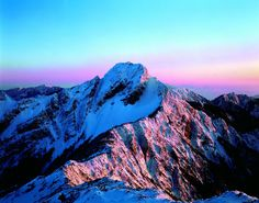 Sunrise over Yushan, often capped with thick snow which makes the entire peak shine like stainless jade thus the name Jade Mountain