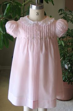 The Tuck Dress sewing pattern by Trudy Horne/Collars Etc. Pattern Company's Tuck Dress pattern in pink Swiss batiste…Classic & heirloom sewing patterns for children by TrudyHorne Baby Girl Dress Patterns, Dress Sewing Patterns, Little Girl Dresses, Clothing Patterns, Girls Dresses, Skirt Patterns, Coat Patterns, Blouse Patterns, Vintage Baby Dresses