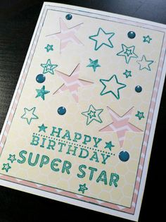 A Bit Of Glue & Paper - handmade greeting card with die cut stars and stamped stars; pink, teal & light yellow; stamped sentiment Happy Birthday Super Star; embellished with enamel dots; Stamp Ink Paper 86 #SIP86