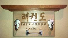 Perfect!  Taekwondo Uniform & Belt Rack - martial arts tae kwon do sparing gear tkd ata. $45.00, via Etsy.