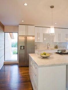 white, modern kitchen. flat cabinets, stainless steel,