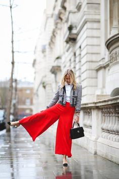 Styling wide leg trousers with a Chanel jacket and slingback shoes.
