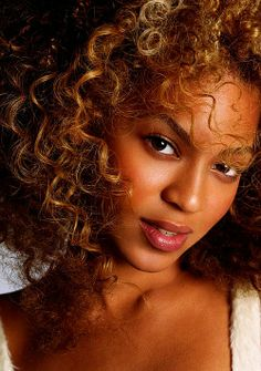 Beautiful natural beauty with curly hair- Beyonce Knowles.