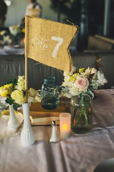 burlap flag table number & shabby chic table decor #tabledecor http://www.weddingchicks.com/2013/11/26/gold-and-gray-wedding/