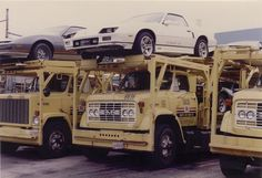 Vintage picture of auto transports getting loaded with Camaros, IROCs, and Firebirds at Norwood Ohio! #AutoTransport #IROC #GMCTruck #Firebird #ThirdGen #TestCarDatabase