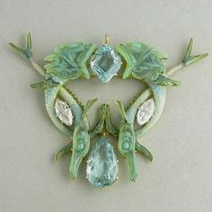 Rene Lalique. Fish pendant. Gold, aquamarine, diamond, enamel, glass. Circa 1900. We love antiques at Renaissance Fine Jewelry in Vermont. www.vermontjewel.com.  Life is short.... so live with the extraordinary!