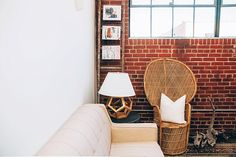 We love our Wicker Peacock Chair, Large Driftwood paired with this sleek and modern sofa from AFR.  And how cool is this magazine rack created with our Rustic Wooden Ladder? Image by Jeffrey Ocampo