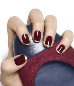 Gilt tip red manicure