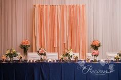 pretty ribbon backdrop for behind the head table. Wedding reception decoration idea.