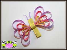 Purple, pink, and yellow butterfly hair clip $4.00